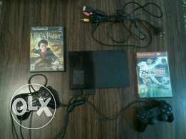 Ps2 with 2 controller and memory card and 2 games