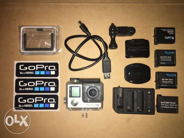 gopro hero 4 black with all its inbox accessories in excellent conditi