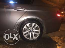 bmw rims r 16 with run flat tires in good condition ( bridge stone )
