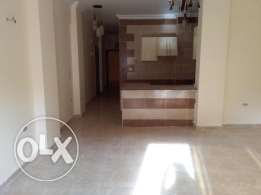 For sale spacious two bedroom apartment in El Kawther area. 400,000LE