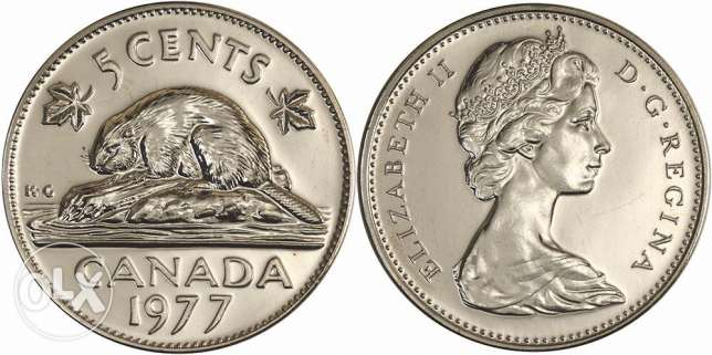 Canadian 5 cents 1977 with error of low 77 and high edge, very rare.