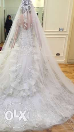 royal wedding dress made by a famous designer