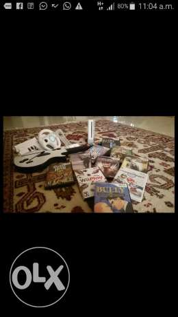 Upgraded wii with 10 games & Guitar
