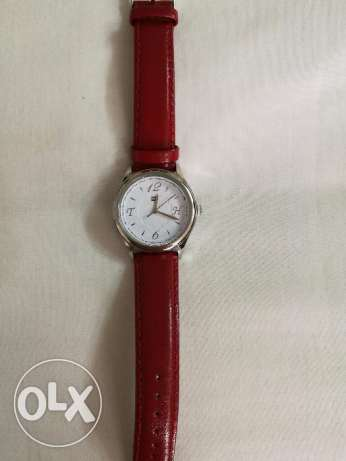 Original Tommy Hilfiger female watch red strap good as new