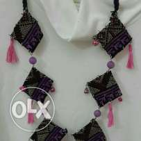 Pinky purple colored necklace