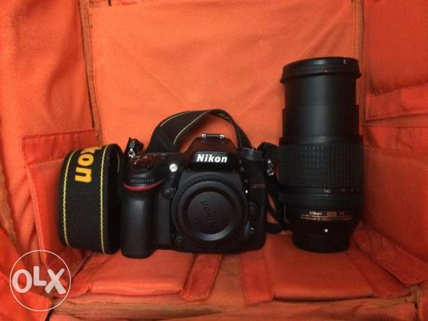 For sale Nikon D7100 with Lens 18-140 used only two monthes وسط القاهرة -  1