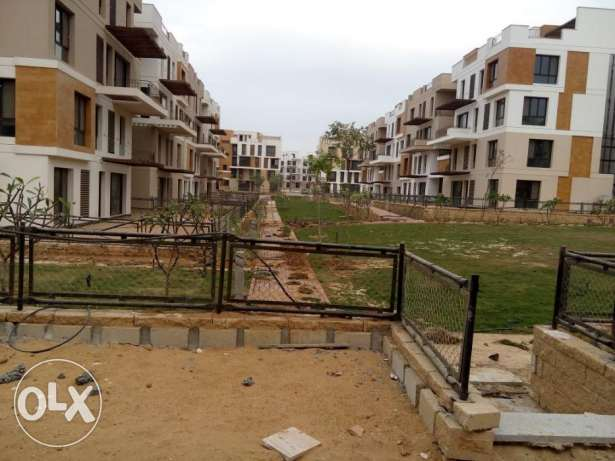 Ground apartment in West town Sodic for sale prime location 190 sqm الشيخ زايد -  2