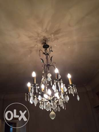 Old antique chandelier in perfect condition and all crystal in place