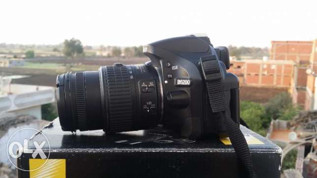 nikon d5200 + 18.55vr2.shutter 11k only.very good condition + tripod