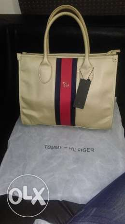 Orginal Tommy bag gold available for immediate purchase
