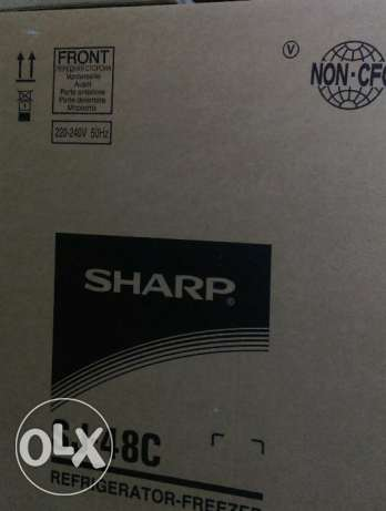 SHARP refrigerator new with invoice and el araby group warranty