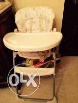 high food chair with levels & toy basket