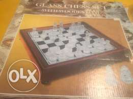 Glass chess set with wooden case