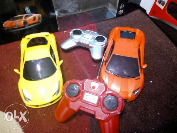 2 R/C cars for sale.