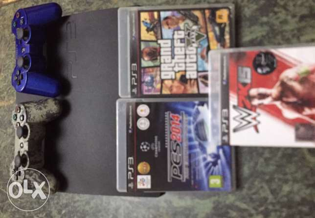 PS3 For sale with 2 joystick and 3 Games (GTA 5 - WWWE 2015 - Pes2014)