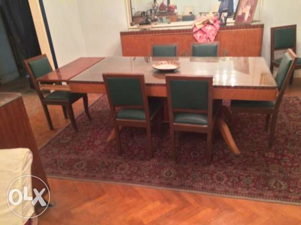 dinning room , table and 3 buffets