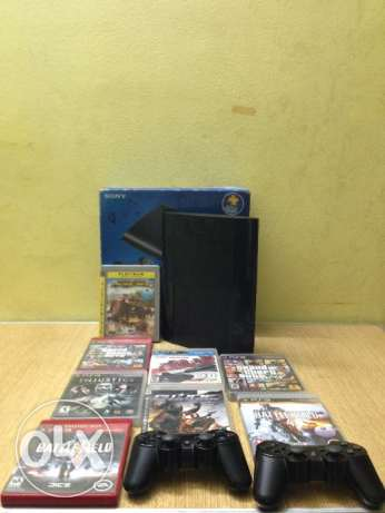 ps3 with games and contralrs