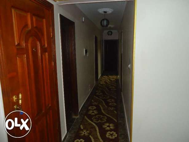 a shared room for rent in a fully furnished apartment in nasr city
