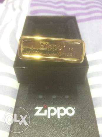 Gold Colored Zippo With A Stripper Logo For Sale المنيل -  3