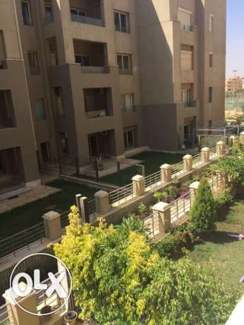 Apartment for rent in the Village garden view القاهرة الجديدة -  1