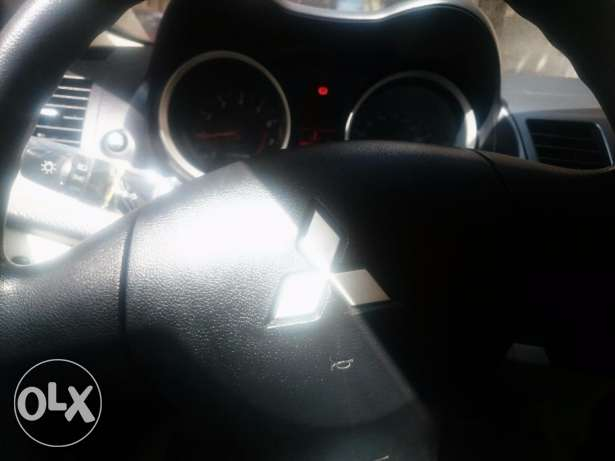 Mitsubishi Lancer 2015 in very good condition fabrica inside and out