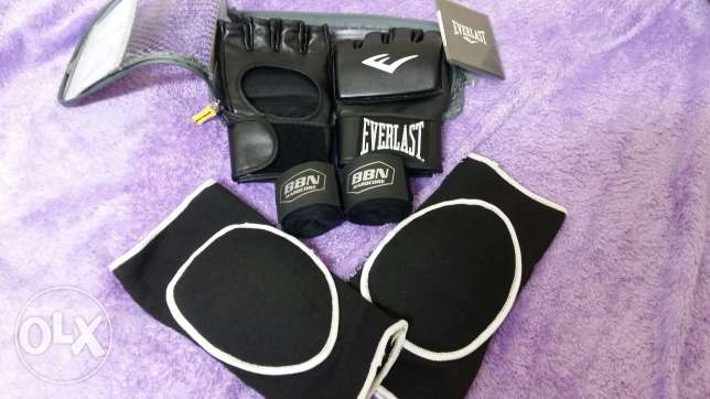 Original MMA gloves, elbow or knee guard and a bandage used once