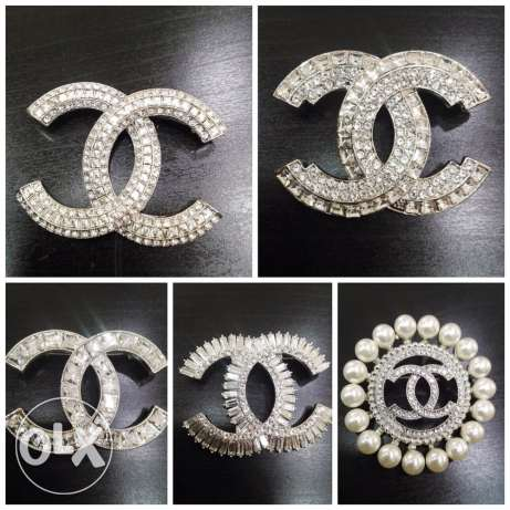 CHANEL brooches.