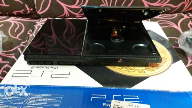 Ps2 + 8 games + 2 joystick with perfect condition