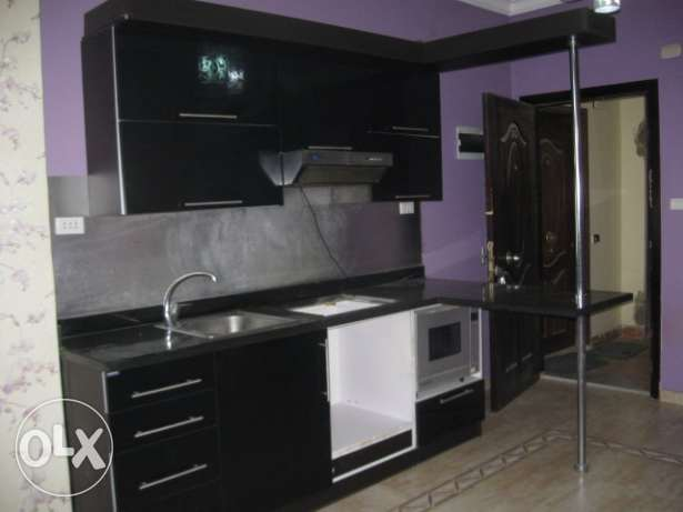 Flat in Kawther, front of airport, building with a sw. pool. 87m, 2br