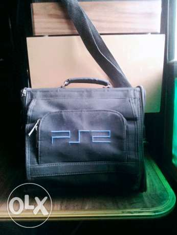 PS2 original and bags and adaptor sale or exchange with guitar