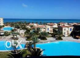 Doublex with swimming pool and beach