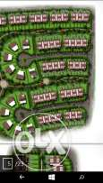 Town house corner land 369 bUA 260, on wide garden. Bahary