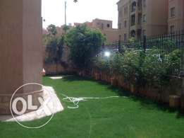 Amazing fully furnished apartment ground floor with garden in compound