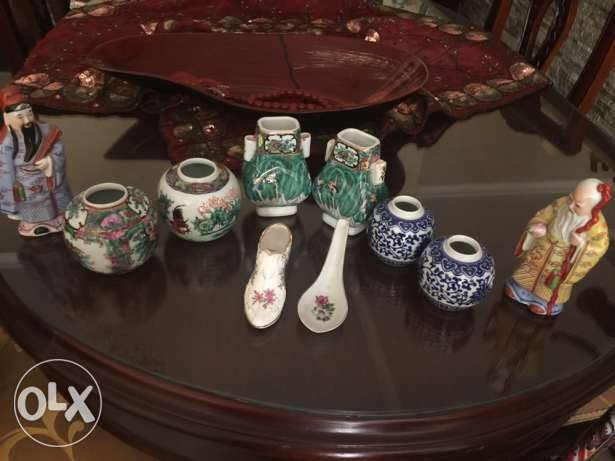 Antique Chinese statues all shown on table altogether