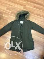 new zara coat for kids 11-12 year may fit smaller never used.