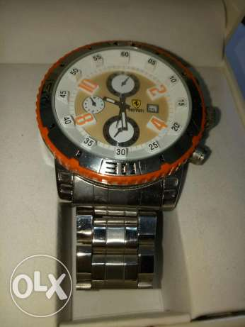 Silver and orange watch