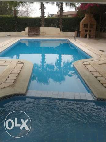 Furnished 5 bedroom villa with huge garden and pool الشيخ زايد -  1