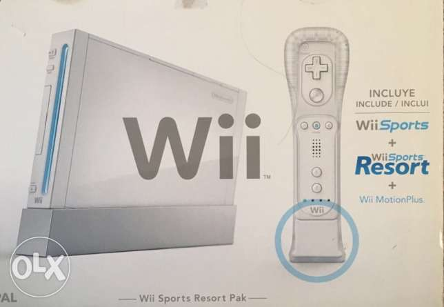 Wii as new in its box + extras