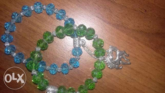 blue and green bracelets. سيدي بشر -  1