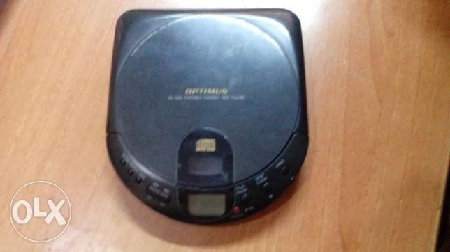 CD -PLAYER -OPTIMUS موديل CD-3360 سنغافورى 2 حجر قلم + ادابتر