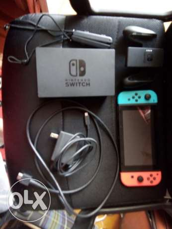 Nintendo switch UNTOUCHED/ neon red and blue controllers