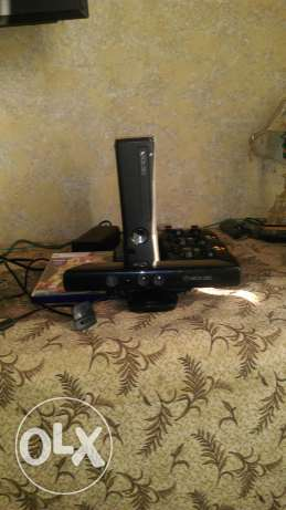 Xbox 360 slim 500 for sale with 1 cd and 27 game