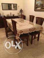 Wooden 06 seat dinning table with extra glass top in very good conditi