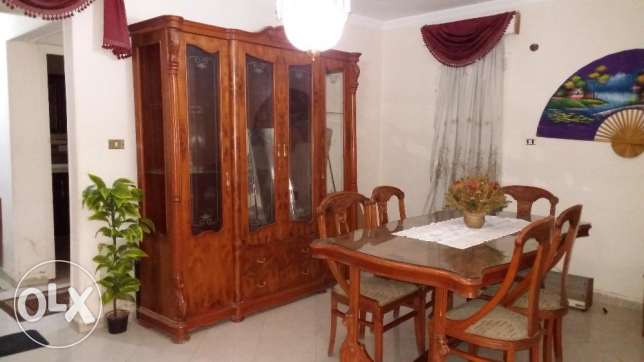For sale Dinning room with 6 chairs, table and cupboard in a good cond