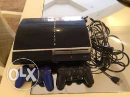 playstation 3 with 2 joysticks and 2 CDs