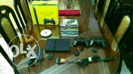 PlayStation 2 with all accessories + 14 games + 2 controllers + memory