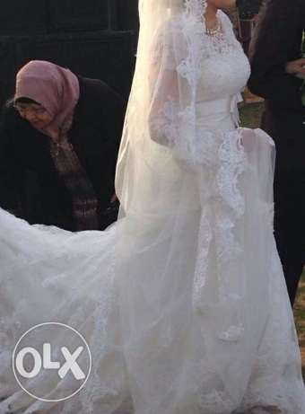 A wedding dress from USA by 1000$ ,,, i wanna sell it only for 8000 LE