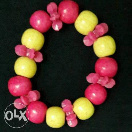 Different colored shaps of children necklaces and bracelet