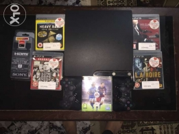 PS3 slim 360 GB and 2 controllers and 5 games