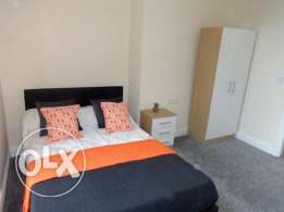 (bed for rent in a shared room in front of Citystars mall (Men Only